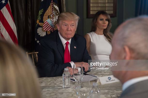 US President Donald Trump listens before a meeting with administration officials and First Lady Melania Trump on the opioid addiction crisis at the...