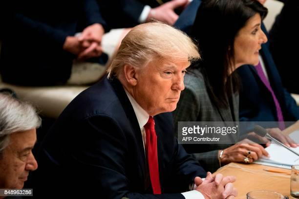President Donald Trump listens during a meeting on United Nations Reform at the UN headquarters on September 18 2017 in New York City / AFP PHOTO /...