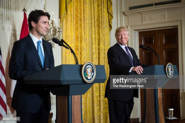 President Donald Trump listens during a news conference with Canadian Prime Minister Justin Trudeau in the East Room of the White House in Washington...