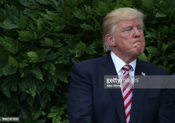 S President Donald Trump listens during a South Lawn event to welcome the Clemson Tigers at the White House June 12 2017 in Washington DC President...