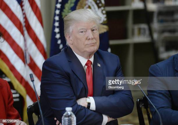 US President Donald Trump listens during a strategic and policy discussion with executives at the White House in Washington DC US on Tuesday April 11...