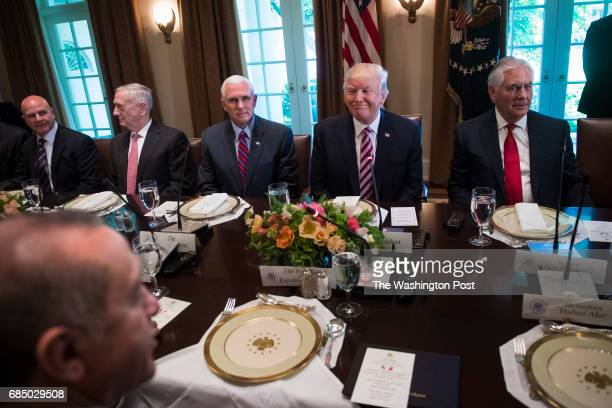 President Donald Trump listens during a working luncheon with Turkish President Recep Tayyip Erdogan in the Cabinet Room of the White House in...