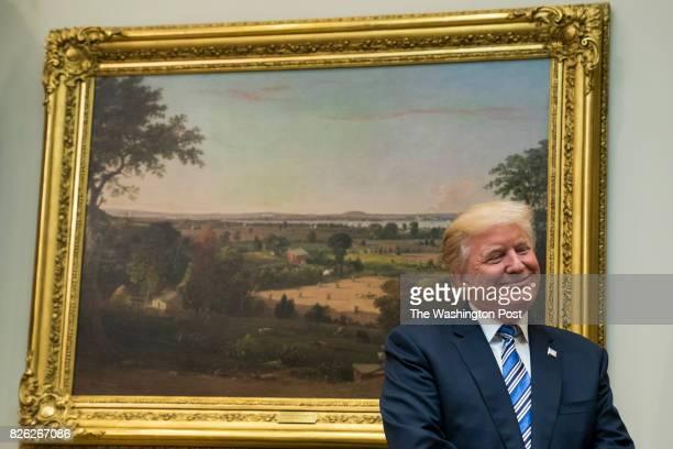 President Donald Trump listens to a presentation by Veterans Affairs Secretary David Shulkin during a Veterans Affairs Department 'telehealth' event...