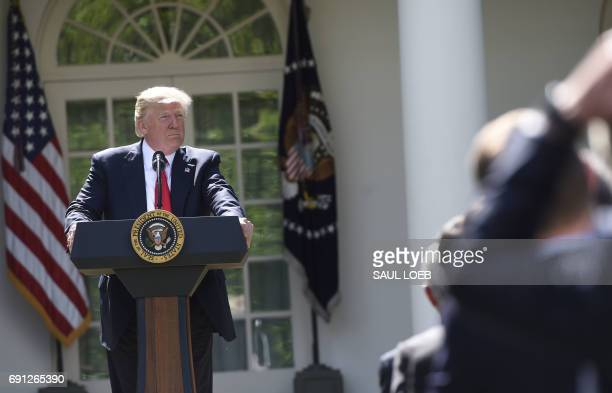 US President Donald Trump listens to a question after he announced his decision to withdraw the US from the Paris Climate Accords in the Rose Garden...