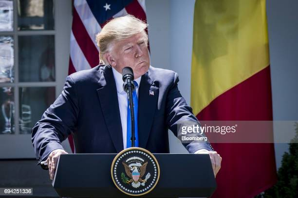 US President Donald Trump listens to a question during a joint press conference with Klaus Iohannis Romania's president not pictured in the Rose...