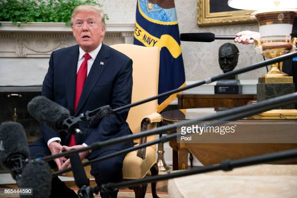 US President Donald Trump listens to a question from the news media as he welcomes Prime Minister Lee Hsien Loong of Singapore to the Oval Office...