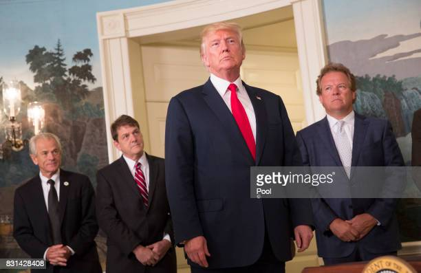 US President Donald Trump listens to a reporter's question after signing a memorandum on addressing China's laws policies practices and actions...