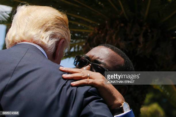 US President Donald Trump listens to African Development Bank President Akinwumi Adesina following a family photo with African leaders after an...