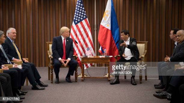 US President Donald Trump listens to Philippine President Rodrigo Duterte during their bilateral meetin on the side line of the 31st Association of...