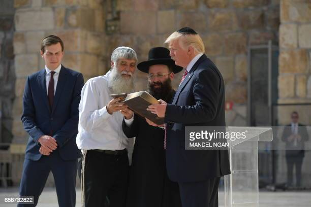 US President Donald Trump listens to Rabbi Shmuel Rabinovitch during a visit to the Western Wall the holiest site where Jews can pray in Jerusalems...