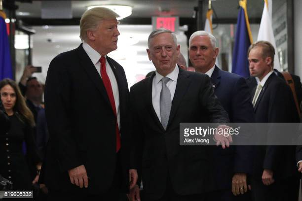S President Donald Trump listens to Secretary of Defense Jim Mattis and Vice President Mike Pence looks on after a meeting in a hallway at the...