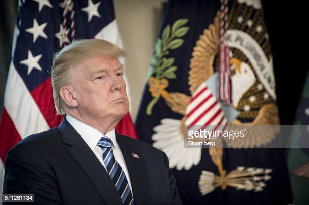 US President Donald Trump listens while Steven Mnuchin US Treasury secretary not pictured speaks before signing an executive order in Washington DC...