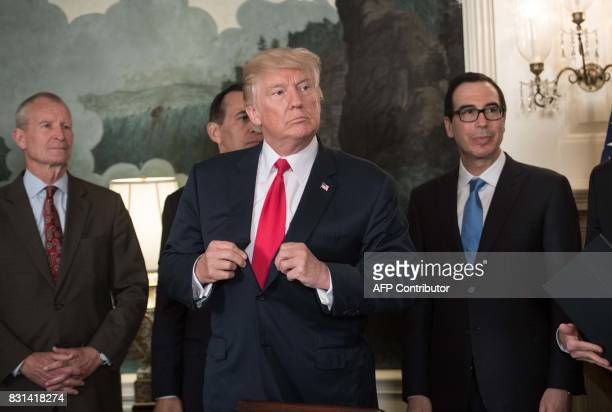 US President Donald Trump looks on after signing a memorandum on addressing Chinas laws policies practices and actions related to intellectual...