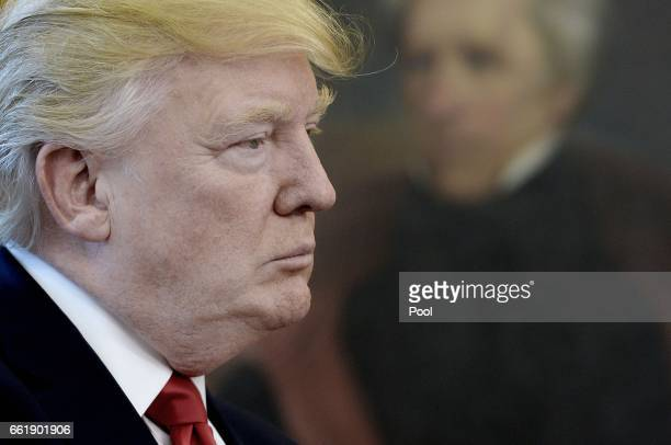 S President Donald Trump looks on after speaking about trade in the Oval Office of the White House March 31 2017 in Washington DC President Trump...