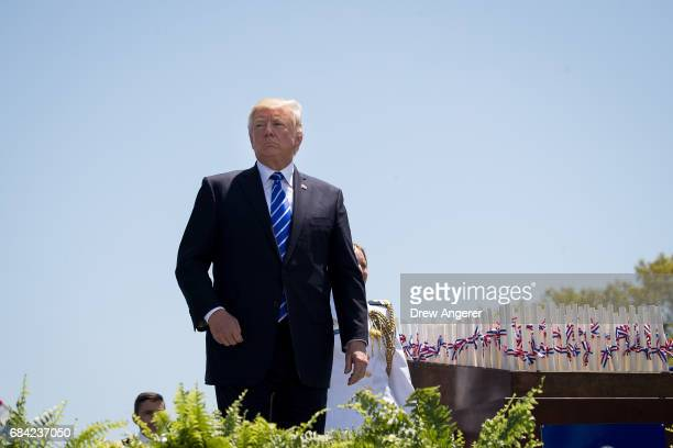 President Donald Trump looks on as he hands out diplomas to Coast Guard cadets at the commencement ceremony at the US Coast Guard Academy May 17 2017...