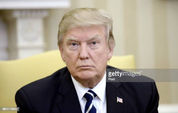 US President Donald Trump looks on as he meets with Egyptian President Abdel Fattah Al Sisi in the Oval Office of the White House on April 3 2017 in...