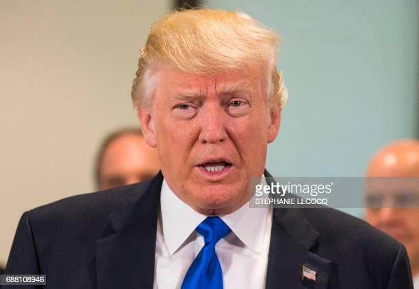 US President Donald Trump looks on during a meeting with EU officials at EU headquarters on the sidelines of the NATO summit in Brussels on May 25...