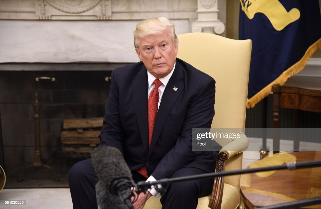 U.S. President Donald Trump looks on during a meeting with President Juan Manuel Santos of Colombia in the Oval Office of the White House, on May 18, 2017 in Washington, DC. They are expected to discuss policies to restrict drug trade and drug cartels.