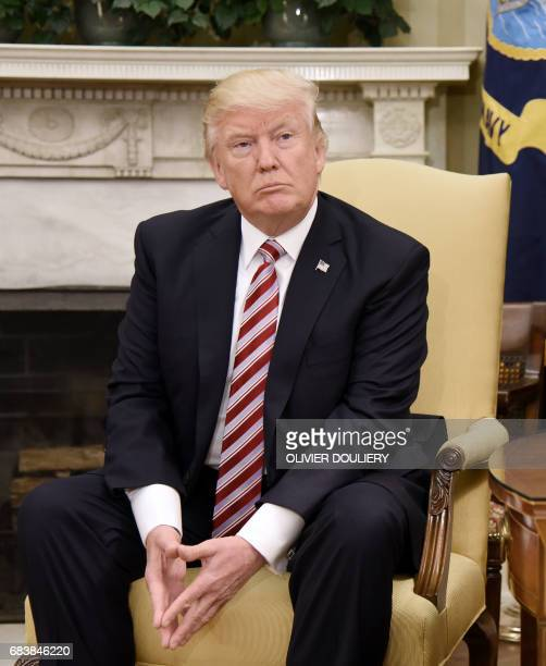 US President Donald Trump looks on during a meeting with President Recep Tayyip Erdogan of Turkey in the Oval Office of the White House in Washington...