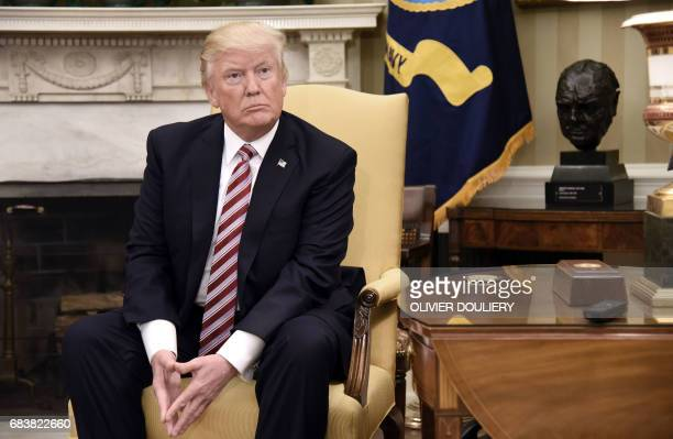 US President Donald Trump looks on during a meeting with Turkish President Recep Tayyip Erdogan in the Oval Office of the White House in Washington...