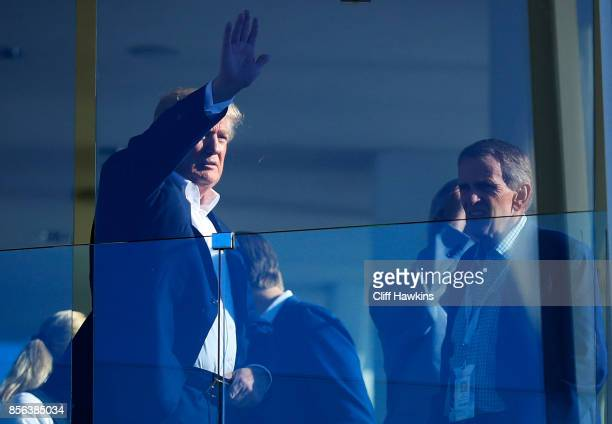 S President Donald Trump looks on from the clubhouse during Sunday singles matches of the Presidents Cup at Liberty National Golf Club on October 1...
