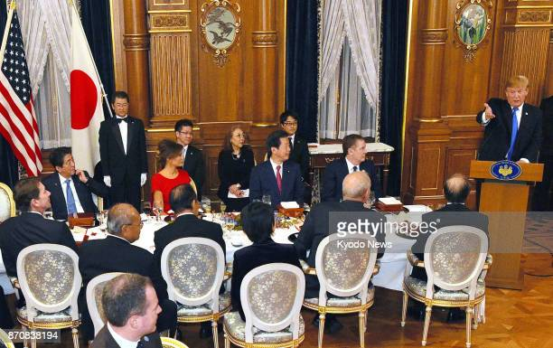 US President Donald Trump makes a speech at a dinner party hosted by Japanese Prime Minister Shinzo Abe at the Akasaka Palace state guesthouse in...