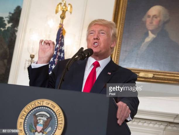 US President Donald Trump makes a statement on the violence this past weekend in Charlottesville Virginia at the White House on August 14 2017 in...