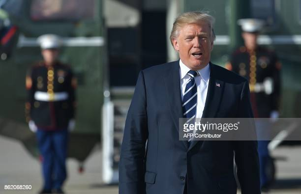 US President Donald Trump makes his way to board Air Force One at Andrews Air Force Base in Maryland before departing for Greenville South Carolina...
