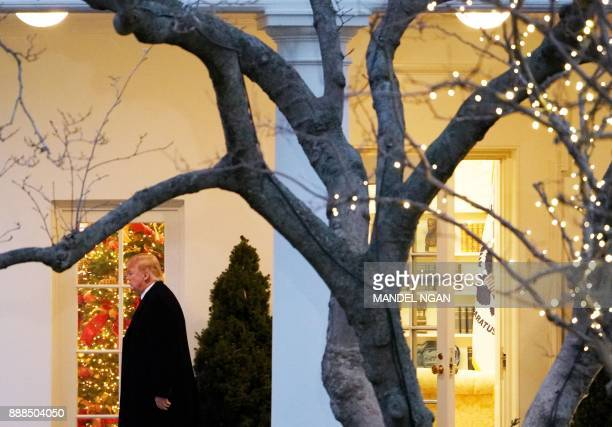 US President Donald Trump makes his way to board Marine One from the South Lawn of the White House on December 8 2017 in Washington DC Trump is...