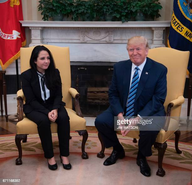 US President Donald Trump meets with Aya Hijazi an EgyptianAmerican aid worker at the White House in Washington DC April 21 2017 Hijazi was flown...