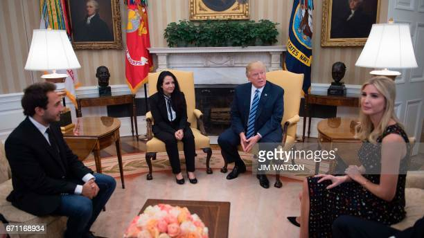 US President Donald Trump meets with Aya Hijazi an EgyptianAmerican aid worker at the White House in Washington DC April 21 2017 as her brother Basel...