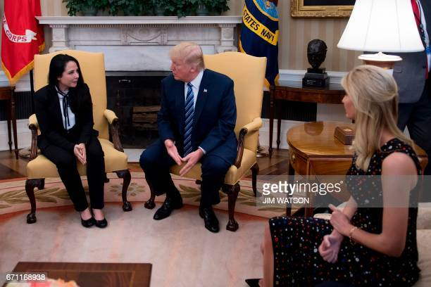US President Donald Trump meets with Aya Hijazi an EgyptianAmerican aid worker at the White House in Washington DC April 21 2017 as daughter Ivanka...