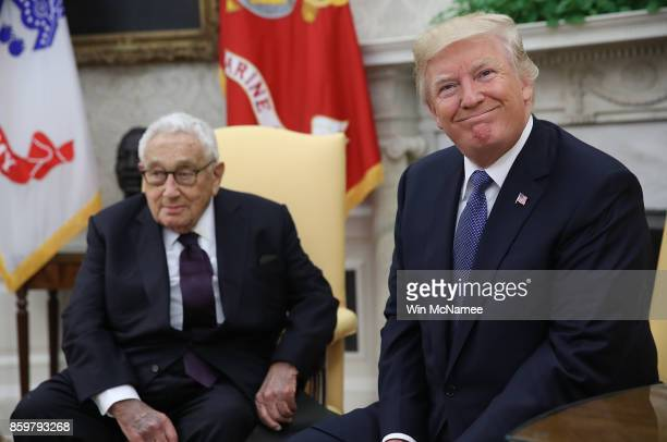 S President Donald Trump meets with former US Secretary of State Henry Kissinger in the Oval Office October 10 2017 in Washington DC Trump answered a...