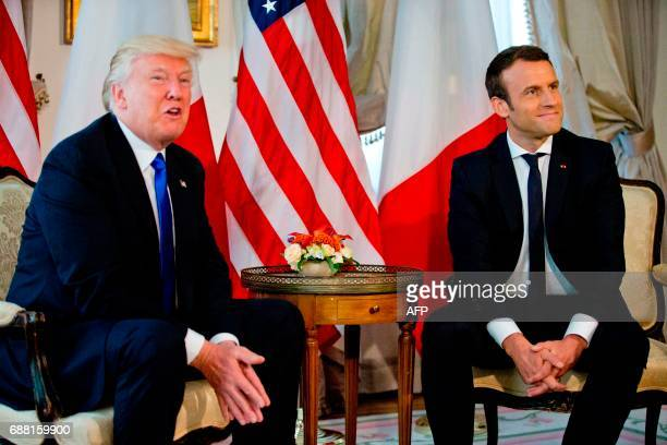 US President Donald Trump meets with French President Emmanuel Macron ahead of a working lunch at the US ambassador's residence on the sidelines of...
