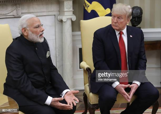 S President Donald Trump meets with Indian Prime Minister Narendra Modi in the Oval Office of the White House June 26 2017 in Washington DC Trump and...