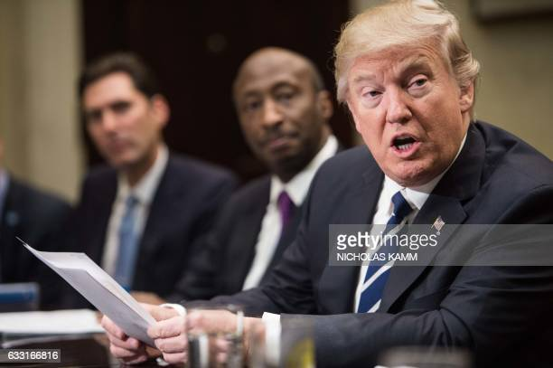 President Donald Trump meets with leaders of the pharmaceutical industry in the Roosevelt Room at the White House in Washington DC on January 31 2017...