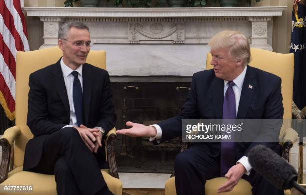 US President Donald Trump meets with NATO Secretary General Jens Stoltenberg in the Oval Office at the White House in Washington DC on April 12 2017...