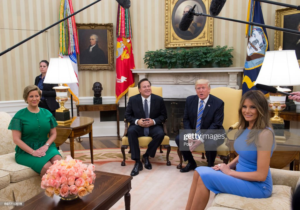 President Donald Trump meets with Panama's President Juan Carlos Varela in the Oval Office at the White House on June 19, 2017 in Washington, DC. Also seated are President Juan Carlos Varela's wife Lorena Castillo and first lady Melanie Trump. According to the White House, the two presidents will talk about how to curb 'transnational organized crime, illegal migration, and illicit substances' and the continued political and economic instability in Venezuela.
