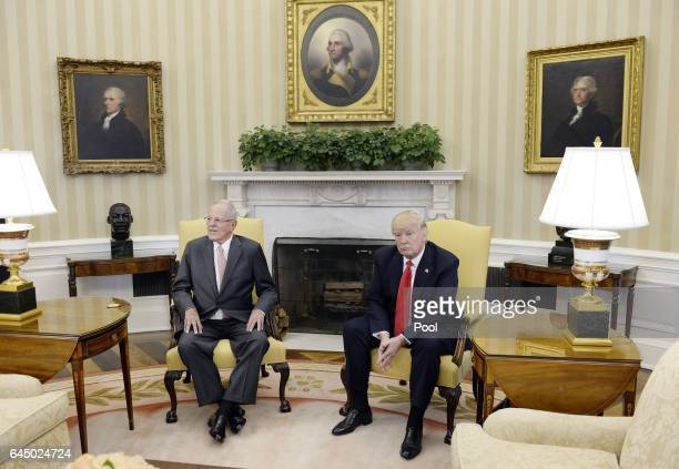 US President Donald Trump meets with President Pedro Pablo Kuczynski of Peru in the Oval Office of the White House on February 24 2017 in Washington...