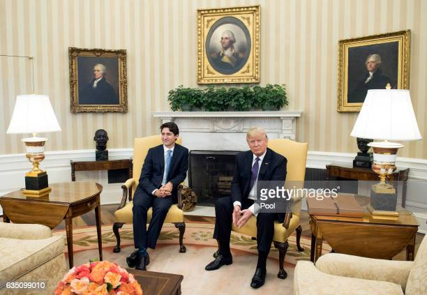 US President Donald Trump meets with Prime Minister Justin Trudeau of Canada in the Oval Office at the White House on February 13 2017 in Washington...