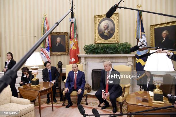 President Donald Trump meets with Prime Minister Nguyen Xuan Phuc of Vietnam in the Oval Office of the White House on May 31 2017 in Washington DC