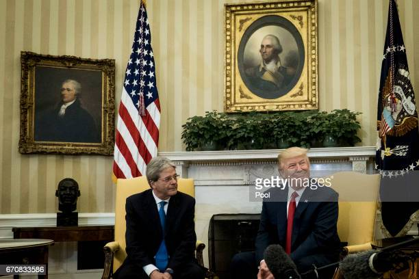 President Donald Trump meets with Prime Minister Paolo Gentiloni of Italy in the Oval Office of the White House on April 20 2017 in Washington DC...