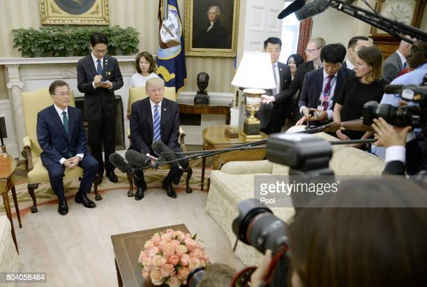 US President Donald Trump meets with South Korean President Moon Jaein in the Oval Office of the White House on June 30 2017 in Washington DC...