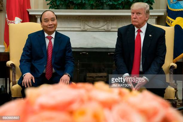 US President Donald Trump meets with Vietnamese Prime Minister Nguyen Xuan Phuc at the White House in Washington DC May 31 2017 / AFP PHOTO / JIM...