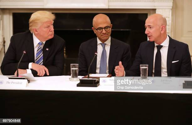 US President Donald Trump Microsoft CEO Stya Nadella and Amazon CEO Jeff Bezos attend a meeting of the American Technology Council in the State...