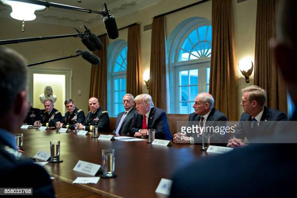S President Donald Trump national security advisor HR McMaster White House chief of staff John Kelly and Defense Secretary Jim Mattis attend a...
