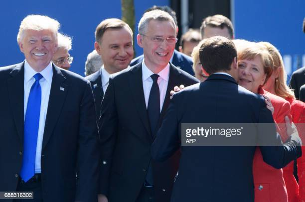 US President Donald Trump NATO Secretary General Jens Stoltenberg French President Emmanuel Macron and German Chancellor Angela Merkel attend the...