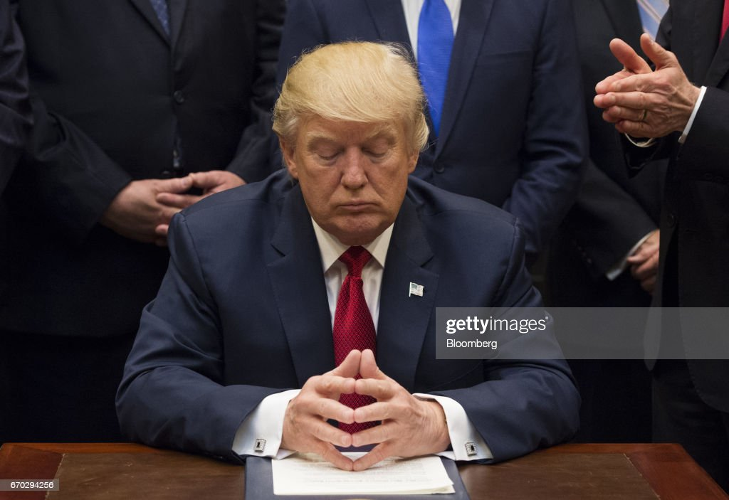 U.S. President Donald Trump pauses after signing bill S. 544, the Veterans Choice Program Extension and Improvement Act, in the Roosevelt Room of the White House in Washington, D.C., U.S., on Wednesday, April 19, 2017 The bill extends a program allowing eligible veterans to seek medical care from private health-care providers. Photographer: Molly Riley/Pool via Bloomberg
