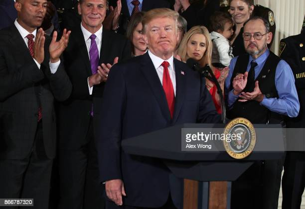 S President Donald Trump pauses as he speaks during an event highlighting the opioid crisis in the US October 26 2017 in the East Room of the White...