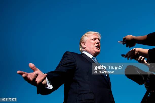 President Donald Trump pauses to speak to the press while boarding Air Force One at Morristown Airport September 24 2017 in Morristown New Jersey /...